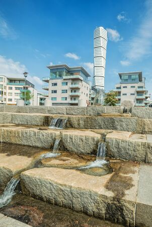 milion: MALMO, SWEDEN - MAY 29, 2016: Sea coast stairs with fountain in Malmo, on May 29, Sweden. Malmo is the third largest city in Sweden with almost halv milion citizens in the urban area.