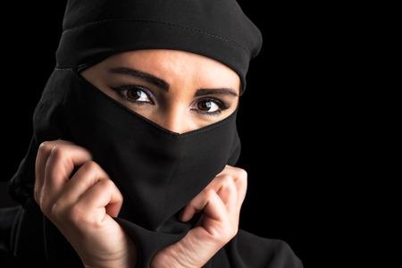 burqa: Muslim woman portrait isolated on black background Stock Photo