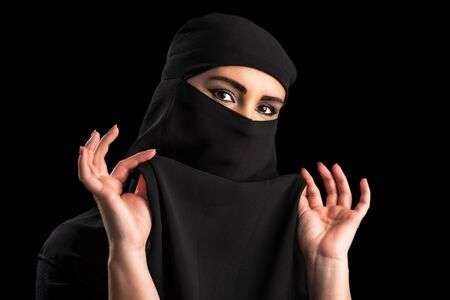 covering the face: Muslim woman covering face Stock Photo
