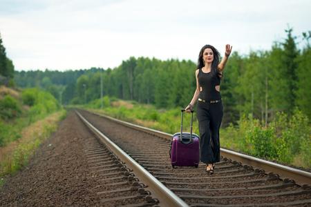 Brunette woman running after train