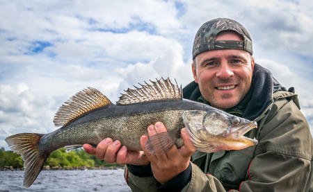 Angler with zander fishing trophy
