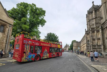 open topped: OXFORD, UNITED KINGDOM - JULY 09, 2016: Red open topped Oxford tour bus along St Aldates, Oxford, Oxfordshire, England, UK, Western Europe, July 09, 2016. Editorial
