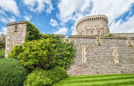 WINDSOR, ENGLAND - JULY 10, 2016: View for old stone walls in Medieval Windsor Castle. Windsor Castle is a royal residence at Windsor in the English county of Berkshire, built in 1066 year