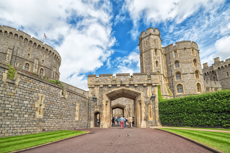 WINDSOR, ENGLAND - JULY 10, 2016: Entry castle architecture in Medieval Windsor Castle. Windsor Castle is a royal residence at Windsor in the English county of Berkshire, built in 1066 year
