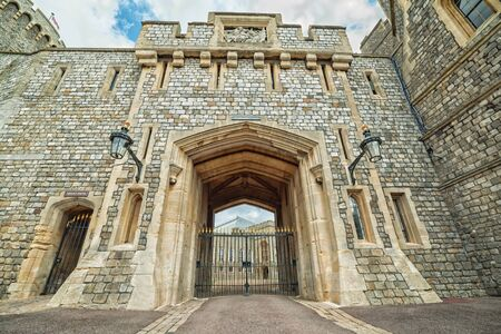 WINDSOR, ENGLAND - JULY 10, 2016: View for entry gate in Medieval Windsor Castle. Windsor Castle is a royal residence at Windsor in the English county of Berkshire, built in 1066 year Editorial