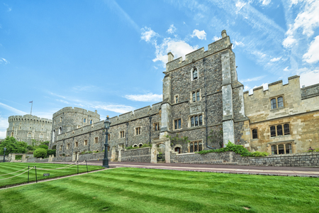 county side: WINDSOR, ENGLAND - JULY 10, 2016: View castle side wall towers in Medieval Windsor Castle. Windsor Castle is a royal residence at Windsor in the English county of Berkshire.