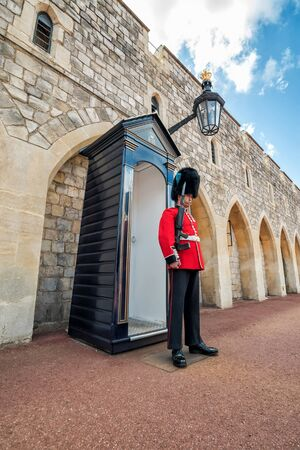 WINDSOR - UK - JULY 10, 2016: Unidentified man member of the royal guard on duty at Windsor Castle, in July 10, 2016 in Windsor, United Kingdom.
