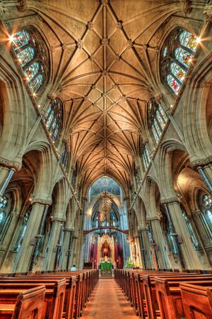 gothic revival: CAMBRIDGE, UNITED KINGDOM - JULY 11, 2016: Our Lady and the English Martyrs chapel interior in vertical view. Its a large Gothic Revival church built between 1885 and 1890.