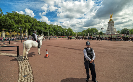 LONDON, UK - 13 JULY, 2016: Guarding policeman before changing the guard ceremony at Buckingham Palace, London, United Kingdom.