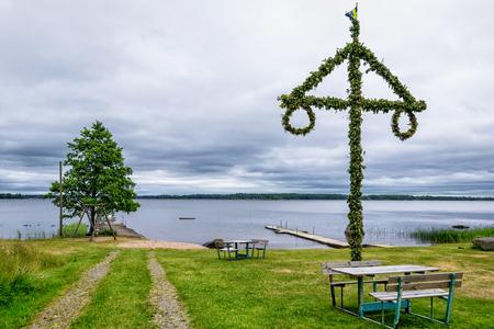 Midsummer maypole on the lake coast