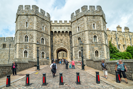 WINDSOR, ENGLAND - JULY 10, 2016: View for exit gate in Medieval Windsor Castle. Windsor Castle is a royal residence at Windsor in the English county of Berkshire, built in 1066 year