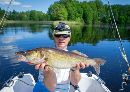 Happy angler with walleye fish