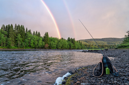 Flyfishing under summer rainbow 写真素材