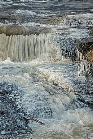 Water cascade in winter scenery