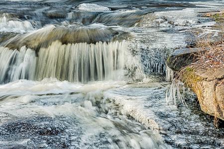 Closeup to winter water cascade