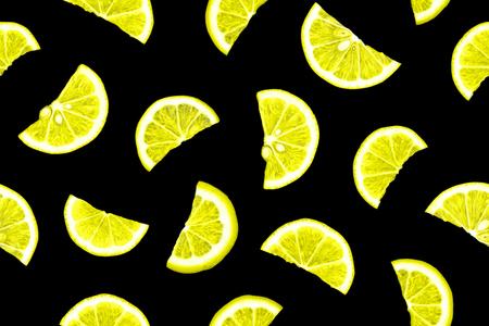 contrastive: Lemon photographic pattern. Seamless photographic pattern. Lemon pattern. Fresh lemon slices isolated on black background. Lemon seamless pattern. Lemon pieces on black background. Stock Photo