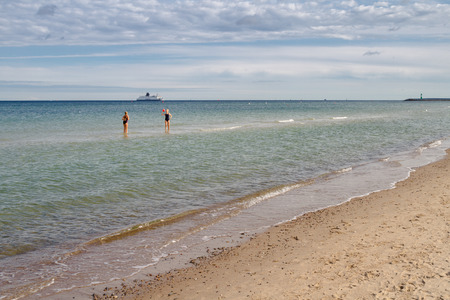 Two women are playing volleyball in the water of the baltic sea