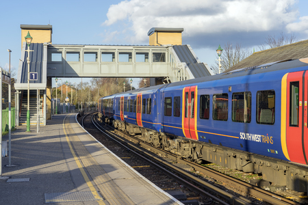 Alton, UK. 13th March 2018. Class 450 Desiro in SWT livery but partially re-branded in South Western Railway logos in Alton station at the end of the Alton Branch Line which serves London Waterloo.