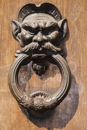 volterra: Doorknob at an old door in Volterra, Tuscany