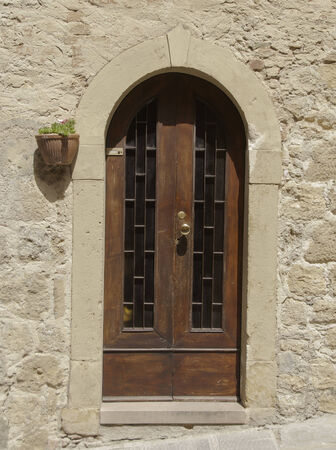 volterra: A weathered old door seen in Volterra, Tuscany Stock Photo