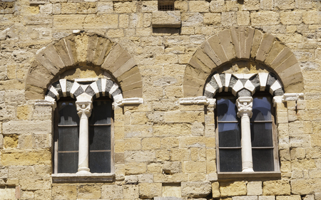 volterra: Old windows in Volterra with marble pillars and archs
