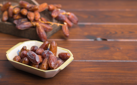 fresh harvested dates on a grey background
