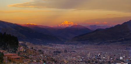 Sunset over Cuzco city peru with the mountains in the background