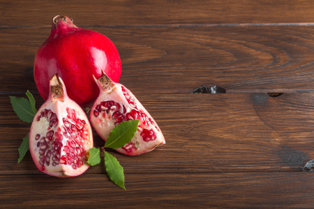 pomegranate on a wooden table on cute in 4