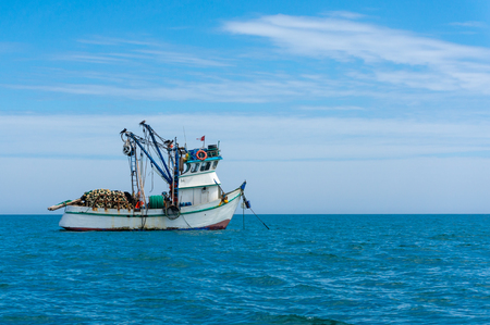 fishing boat in the pacific ocean Banco de Imagens