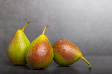 Qtee is a new variety of pear made mainly in europe, whole on a gray background Reklamní fotografie