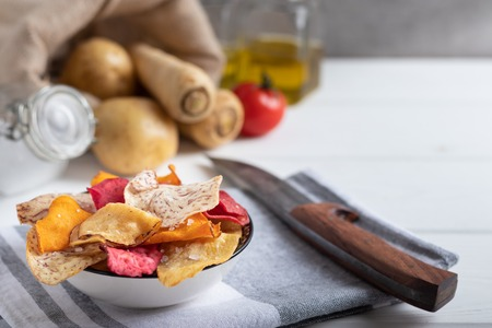 Root Vegetable chips made of sweet potato,beetroot,parsnip,manioc and taro with sea salt.