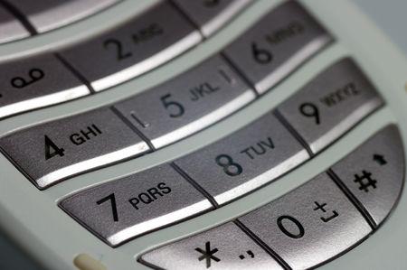 A closeup of a keypad on a mobile phone