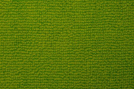 Close-up of an green indoor warm and soft carpet.