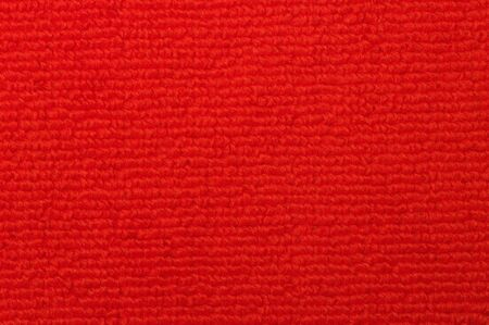 Close-up of an red indoor warm and soft carpet.