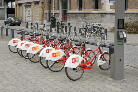 velo: Antwerp, Belgium - February 22, 2014: Bicycles for rent parked on the street. Velo is among largest bike sharing systems worldwide. Editorial