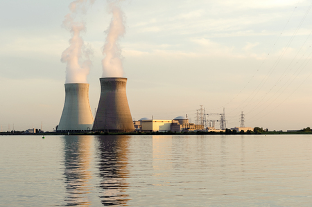 nuclear reactor: The smoke from chimney of thermoelectric power station, nuclear power plant, Doel, Belgium Stock Photo