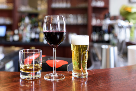 redwine: Alcohol drinks on a bar in a restaurant Stock Photo
