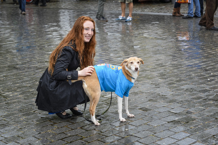 breda: Breda, The Netherlands - September 5, 2015: Young lady with red hear and dog are exposing on the RedHead Days.