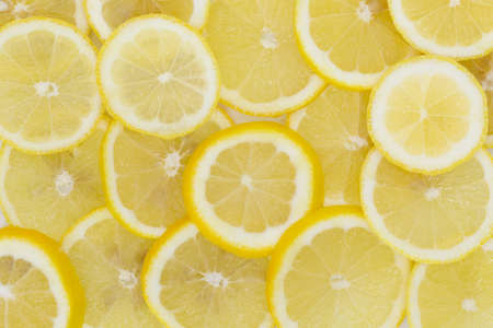 Many healthy lemons cut and placed side by side as a background. horizontal