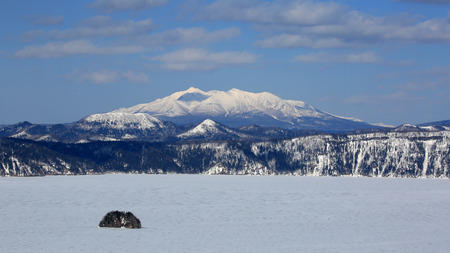 Volcanic lake and mountain in winter 写真素材