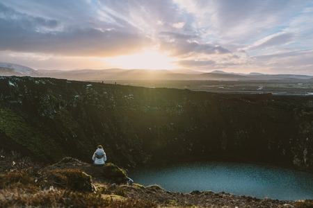crater lake: Hiking erupted Volcano Kerid in South Iceland with a beautiful sunset.