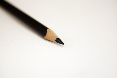 black pen tip on white background and pencil