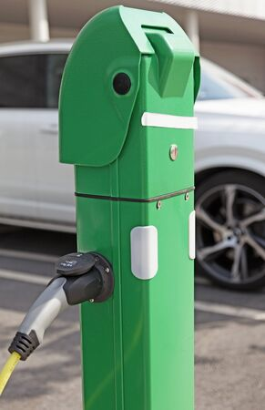 green electric pole for refueling electric cars outside the Avion gallery in Umea