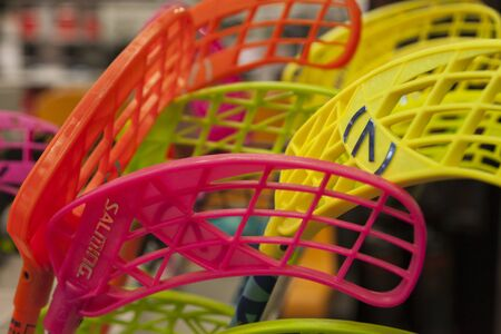 Umea, Sweden - September 9, 2019: lots of floor ball sticks in different bright colors for sale Editorial