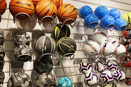 Umea, Sweden - August 29, 2019: many different balls in a sports shop