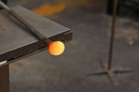 melted hot pulp slowly formed by a glass artist at Roback Stock Photo