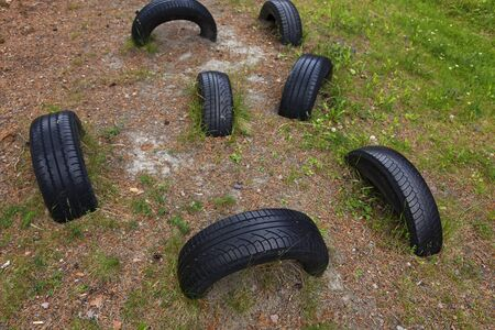 tires buried in the ground to the obstacle course
