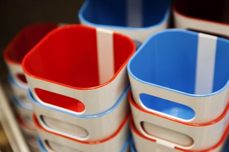 toothbrush mugs stacked in red and blue