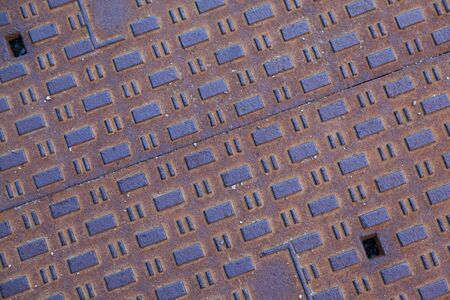 pattern and texture on well cap in Uppsala Stockfoto