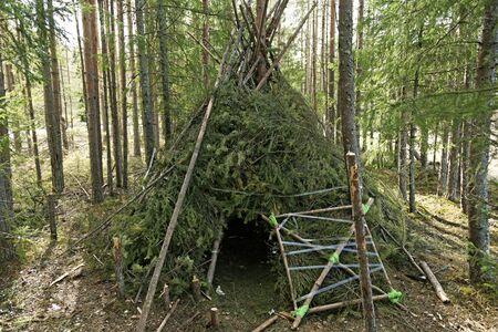 a forest hut built like an Indian tipi